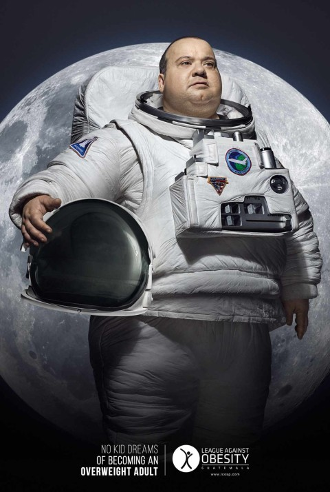 Photo of obese man in astronaut costume