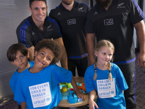 Football and rugby players team up to test their skills against children