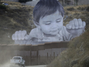 Giant toddler mural protests Trump's wall of shame